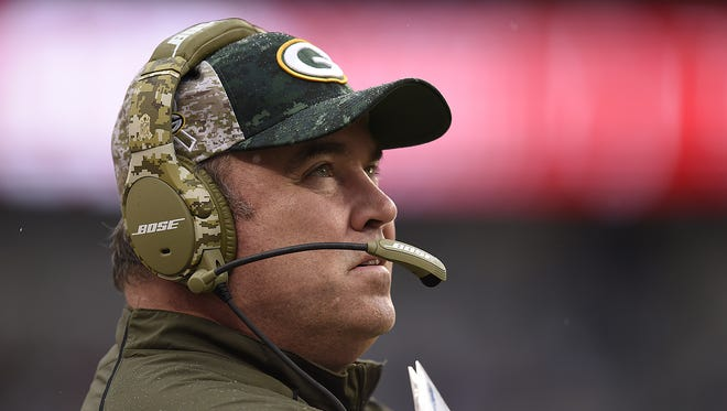 Green Bay Packers coach Mike McCarthy looks on during Sunday's game against the Carolina Panthers at Bank of America Stadium in Charlotte, NC.