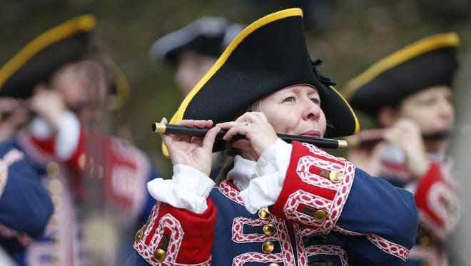 The Tippecanoe Ancient Fife  & Drum Corps play a tune as guests await the arrival of the voyageurs during the Feast of the Hunters' Moon Saturday, October 1, 2016, at Fort Ouiatenon.