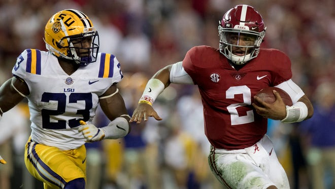 Alabama quarterback Jalen Hurts (2) is pursued by LSU linebacker Corey Thompson (23) in first half action at Bryant Denny Stadium in Tuscaloosa, Ala. on Saturday November 4, 2017.