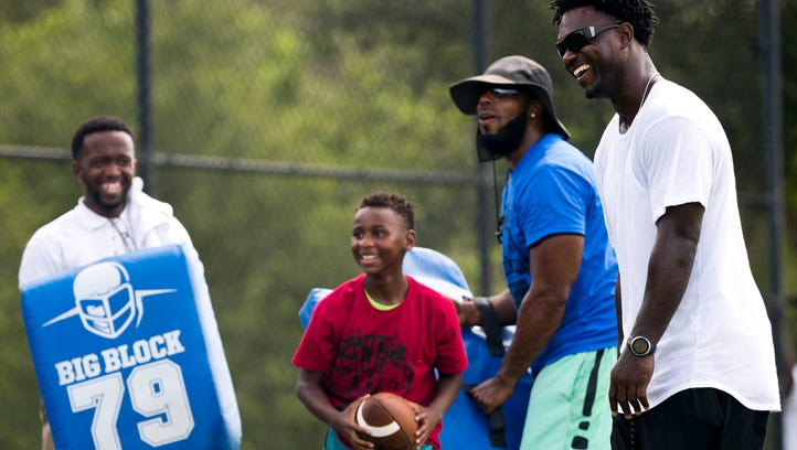 Edgerrin James, far right, shares a laugh with the