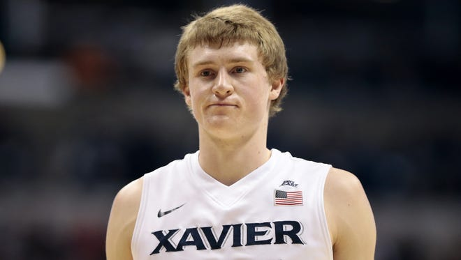 Xavier guard J.P. Macura lines up to shoot a free throw Feb. 17 against Providence.
