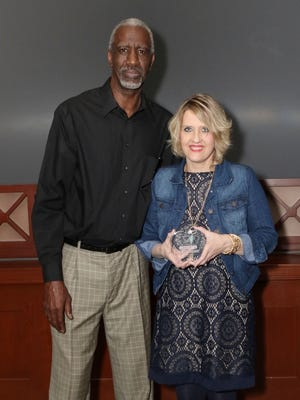 Mrs. Guillerman Soto is being presented her award by Alvin Smith, a Kentucky State basketball player inducted into the Naismith Basketball Hall of Fame.