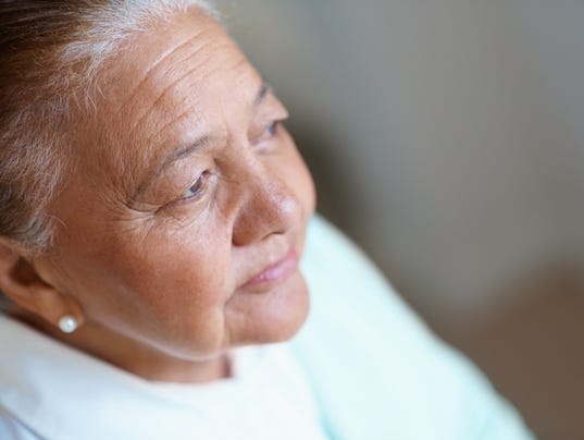 Close-up of a worried old woman
