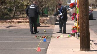 Two Arizona Department of Public Safety officers investigate  March 31, 2016, the scene where 27-year-old Loreal Tsingine was fatally shot by a Winslow, Ariz., police officer on March 27, 2016.