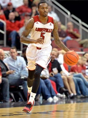 Louisville's Kevin Ware brings the ball upcourt during a game on Nov. 19.