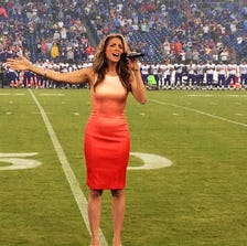 Janine Stange sings the national anthem at the Titans game Thursday.