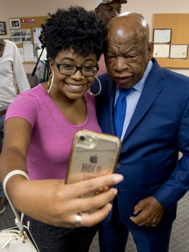 Akaninyene Ruffin takes a selfie with U.S. Rep John
