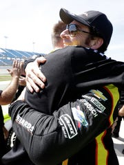 Simon Pagenaud, right, celebrates with pit crew members after winning the pole position for the IndyCar series Iowa Corn 300 on Saturday, July 9, 2016, at the Iowa Speedway in Newton.