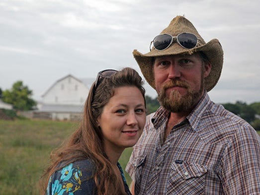 Kate and Travis Reich of White Barn Co in New Hope poise together on their farm where they raise and sell Hampshire hogs for slaughter using a combination of pasture and conventional feed. But with the help of a Valley Conservation Council grant, they'll soon be harvesting and milling their new corn with GMO-free alfalfa and clover hay to feed the livestock, so they can offer all-natural meat.
