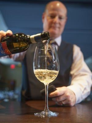 Sommelier Chris Wanamaker pours a glass of Benito Ferrara 2013 Vigna Cicogna at Caffe Aldo Lamberti in Cherry Hill.