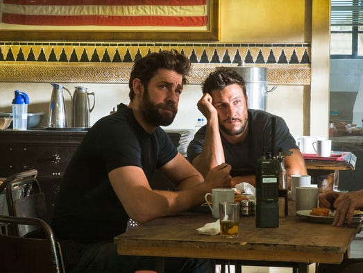 "John Krasinski, left, plays Jack Silva, in ""13 Hours:"