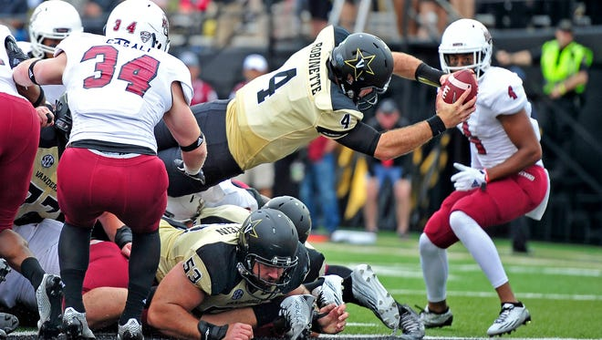 Quarterback Patton Robinette dives into the end zone in the second quarter Saturday for Vanderbilt's first offensive TD of the season.