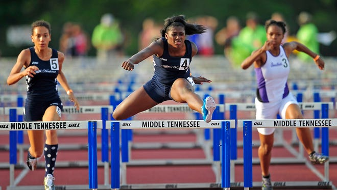 Northeast's Brittany Kelly (4) leads the Class AAA 100 meter hurdles at the TSSAA Track & Field State Championships at MTSU in Murfreesboro, Tenn., Thursday, May 20, 2014.