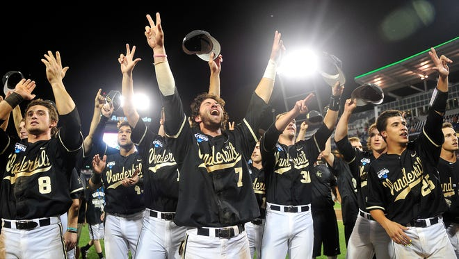 Vanderbilt players celebrate a 4-3 win over Texas at the College World Series at TD Ameritrade Park in Omaha, Neb., Saturday, June 21, 2014.