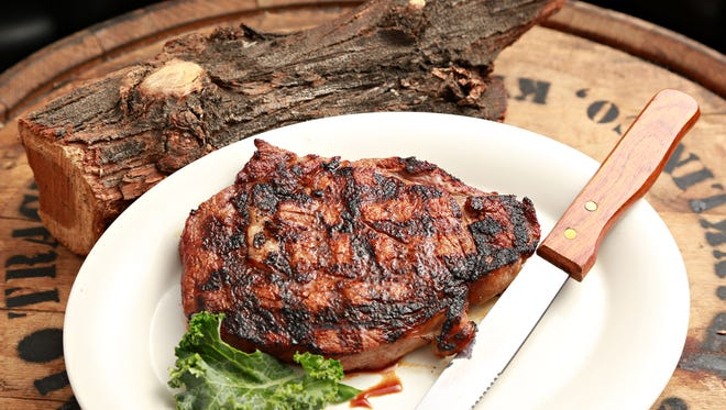 Steaks are cooked over a fire of mesquite coals, as suggested by Chef Mark Hittle of Bobby Q's