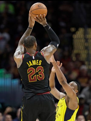 Cleveland Cavaliers' LeBron James takes the game-winning three point shot over Indiana Pacers' Thaddeus Young. he Cavaliers won 98-95.
