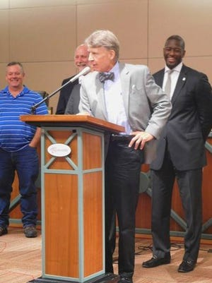 Gerald Ensley, center, accepts a key to the city