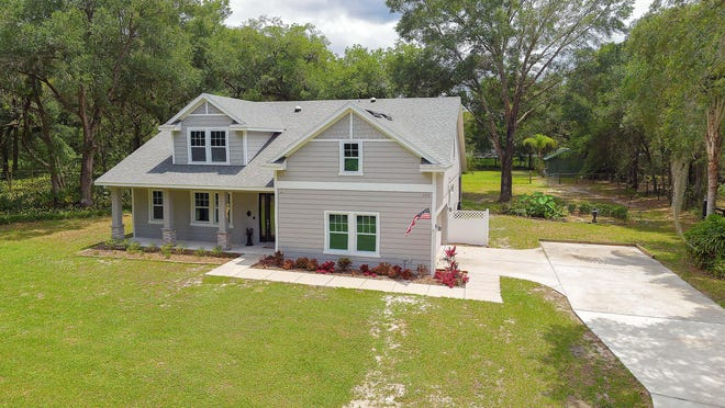 This beautiful two-story block home in DeLeon Springs is nestled among huge oaks on 3.7 fully fenced acres, with more than 2½ acres of cleared pasture that is ideal for horses, cows, goats or other farm animals.