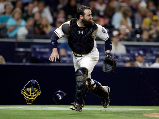 FILE - In this Sept. 10, 2016, file photo, San Diego Padres catcher Derek Norris runs during the eighth inning of a baseball game against the Colorado Rockies in San Diego. The Nationals reacquired  Norris in a trade with the Padres on Dec. 2 (AP Photo/Gregory Bull, File)