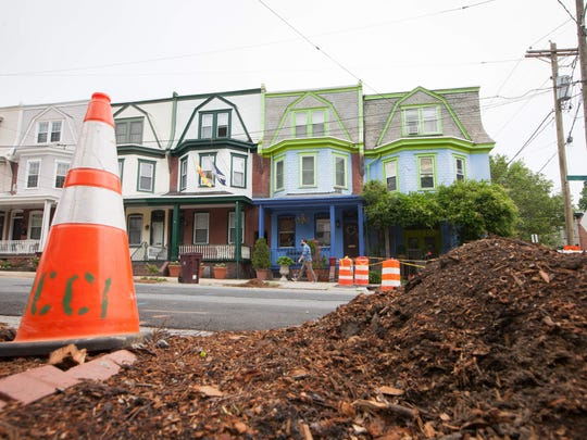 Wood chips made from trees that once lined the 1800 block of Delaware Avenue in Wilmington are shown Tuesday. The trees were removed as part of a streetscape project.