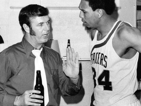Indiana Pacers coach Bob Leonard with Mel Daniels (and beer and cigarette) in 1973.