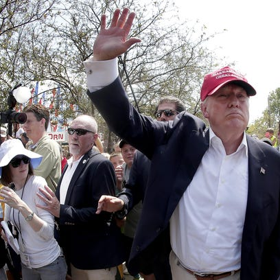 In this Aug. 15, photo, Republican presidential candidate Donald Trump waves to the crowd at the Iowa State Fair in Des Moines. Trump wants to deny citizenship to the babies of immigrants living in the U.S. illegally as part of an immigration plan that emphasizes border security and deportation for millions.