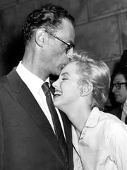 Actress Marilyn Monroe, right, leans against her fiance, playwright Arthur Miller, in her apartment house in New York, June 22, 1956. (AP Photo)