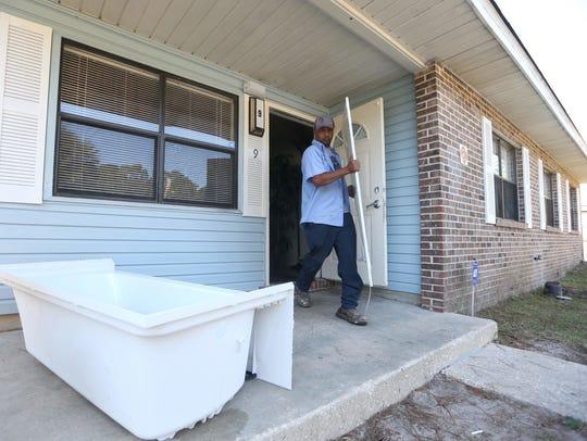 Joe Rondone / Democrat Maintenance workers Jerry Maul
