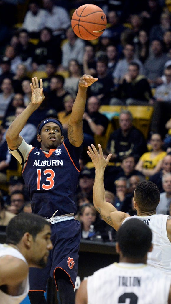 Auburn's Tahj Shamsid-Deen shoots against Colorado.