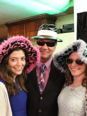 Cumberland County Freeholder James Sauro poses with Dominique Miller (left) and Danielle Sauro (right) outside the photo booth.
