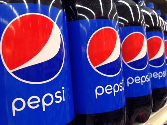 FILE - In this July 9, 2015, file photo, Pepsi bottles