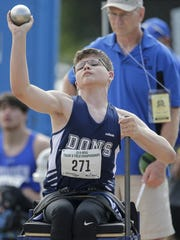 Columbus Catholic's Noah Eckelberg throws in the shot put wheelchair event during the WIAA state track meet in La Crosse.
