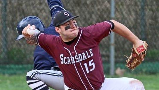Scarsdale third baseman Tyler Mandel makes a throw