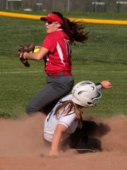 Sydney Hoover prepares to throw the ball to first base after getting Megan Payne out at second. Northridge hosted Utica Tuesday night, but lost 9-4.