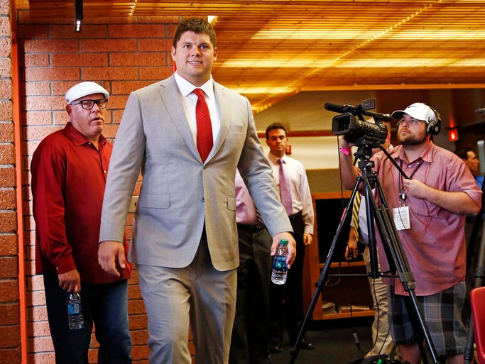 Arizona Cardinals' Jared Veldheer arrives to a news conference on Wednesday, March 12, 2014, in Tempe.