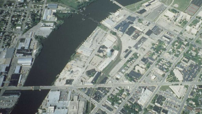 An pre-redevelopment photo shows an aerial view of the Pearl Avenue-Marion Road area looking west.