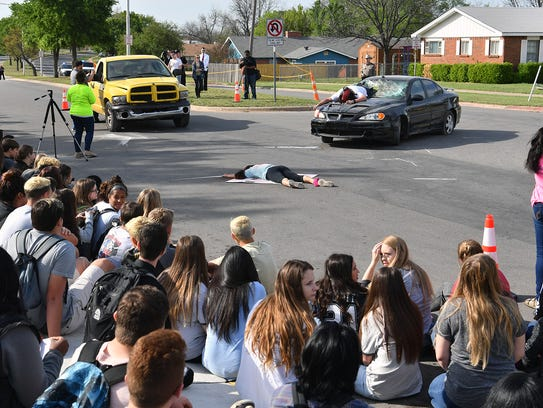 Rider High School juniors and seniors gathered as witnesses