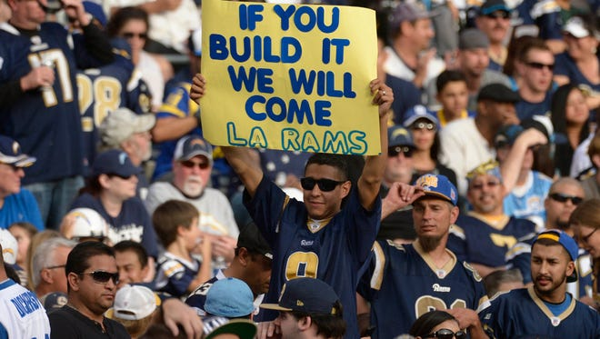 Rams fans in San Diego for a game against the Chargers this season plead for the team to return to Southern California.
