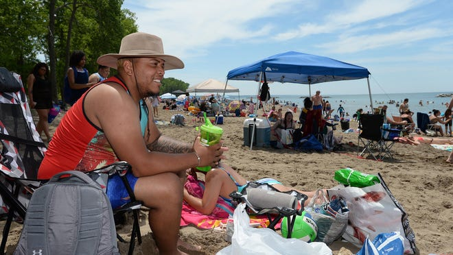 Jomar Gomez, 25, of Jamestown, New York, relaxes July 4 at Beach 6, Presque Isle State Park.