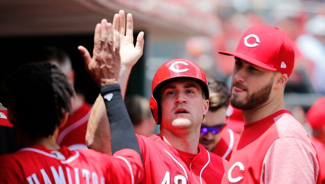 Cincinnati Reds right fielder Scott Schebler (43) is congratulated after scoring in the sixth inning against the St. Louis Cardinals June 8, 2017, at Great American Ball Park.