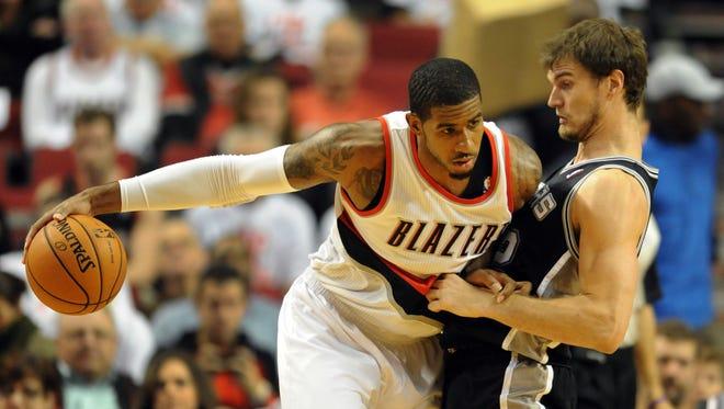 Portland Trail Blazers power forward LaMarcus Aldridge (12) dribbles against San Antonio Spurs center Tiago Splitter (22).