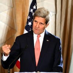 U.S. Secretary of State John Kerry gestures as he speaks to the media on Aug. 12, 2014