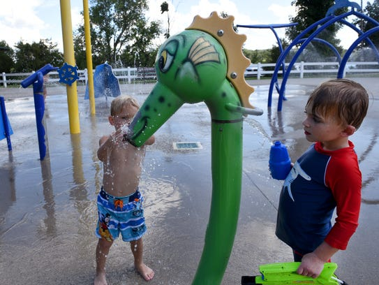 Benjamin Duvall, right, 3, and Asher Millsaps, 3, playing