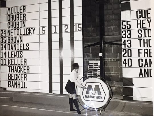"""The caption on this 1969 photo reads: """"Who scored what? The new Marathon scoreboard at the (State Fair) Coliseum will tell you. The tallycard is now in use for all Indiana Pacer home games."""" The gong, also new, would be sounded when a Pacers player hit a three-point basket."""