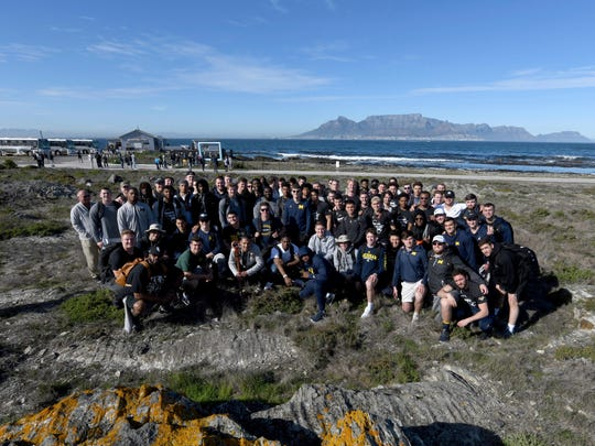 Michigan football players pose for a photograph during their visit to Robben Island in Cape Town, South Africa, Sunday, May 5, 2019. The team visited the former prison Island where former President Nelson Mandela spent time.