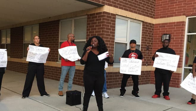 April Grant, a 29-year-old Camden resident, spoke Tuesday at the first rally organized by the Camden chapter of  Black Lives Matter. The group's People Conference was held outside the district's school board meeting at the H.B. Wilson Family School in Camden.