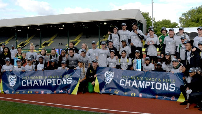 Members of the Oregon Ducks mens and womens teams pose after winning the team titles during the Pac-12 Championships at Hayward Field.