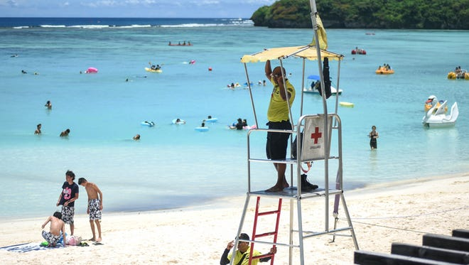 Visitor Safety Officer Fletcher Persinger looks out to the beach in Tumon, near the Outrigger Guam Resort, on Wednesday, Aug. 9, 2017. Sonja Sanchez, Visitor Safety Officer Program supervisor, said a certified lifeguard from this tower responded to drowning incident near the Hyatt Regency Guam.