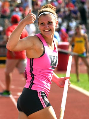 West Lafayette's Maria Siciliano gives a thumbs up to the crowd after clearing the bar in the pole vault during the girls IHSAA track and field state finals at Robert C. Haugh Track and Field complex in Bloomington, Ind. on Friday.