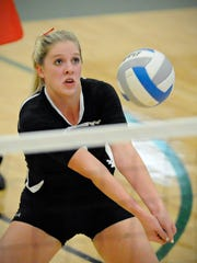 Rocori's Abby Templin bumps the ball Thursday against St. Cloud Cathedralat Sauk Rapids.